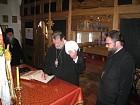 Met. Christopher signs the Gospel