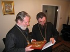 Archbishop Nikolae presents the Metropolitan Christopher with a hand-painted icon of Constantine & Elena