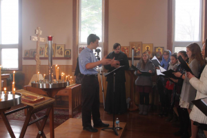 Gabriel Sander conducting during Liturgy