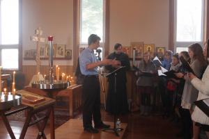 Gabriel Sander conducting during Liturgy