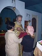 Fr Thomas giving Communion
