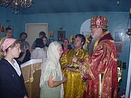 Bishop Peter greeting the people with the Cross and prosphera