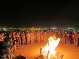 Christmas carols by bonfire at Camp Leatherneck