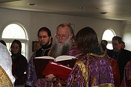 Bishop Peter reading prayers for the lesser blessing of the expanded parish church