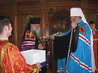 Met. Christopher presents Bishop Peter with a bowl to use for Holy Water